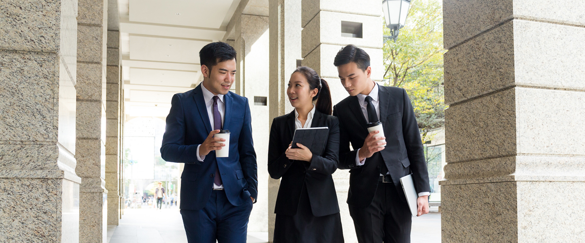 Group of business people walking, street, asian