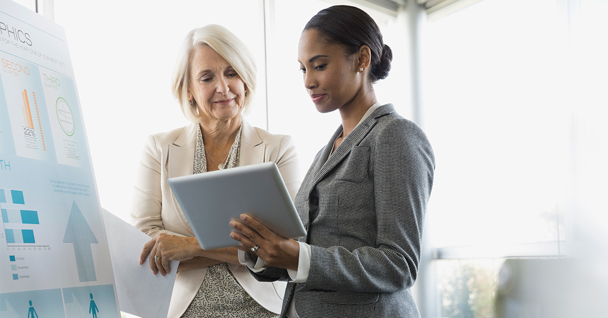 Businesswomen discussing in boardroom, meeting, conference, two people, diverse, women