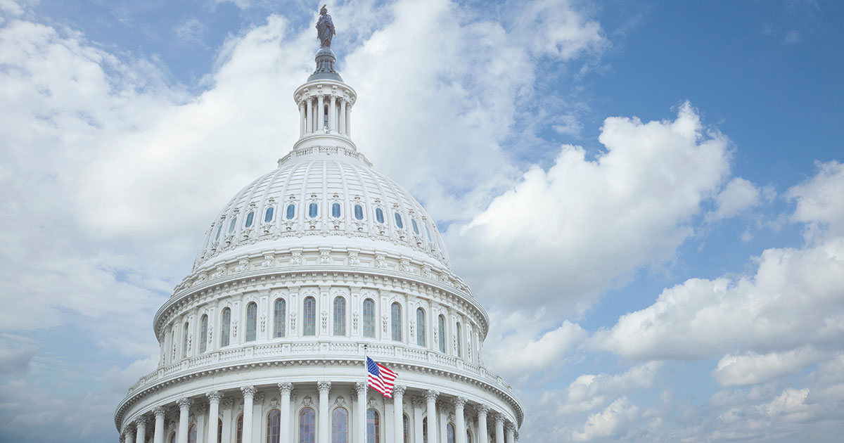 Low-angle view of United States Capitol building against cloudy sky in Washington, DC, US, government, legislative